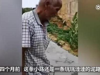 七旬老翁挑担修土路:让孩子上学路好走