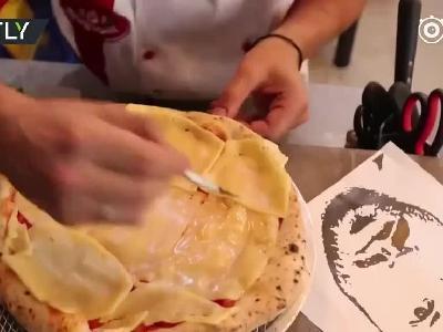 视频:俄罗斯披萨师巧手做球员头像披萨 栩栩如生