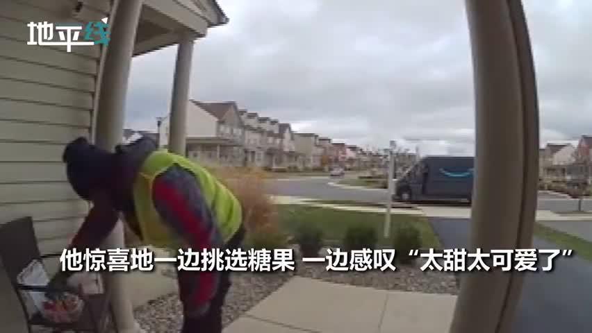 视频-快递小哥发现户主在门口留了糖 像孩子一样开