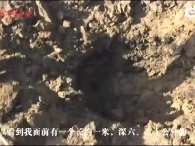 缅甸炮弹落中国境内炸出大坑