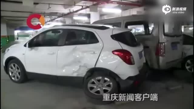 女司机车库连撞8车 两辆路虎车头被撞粉碎