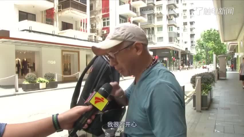 视频-面对大陆记者香港阿叔流下眼泪:香港被搞成这