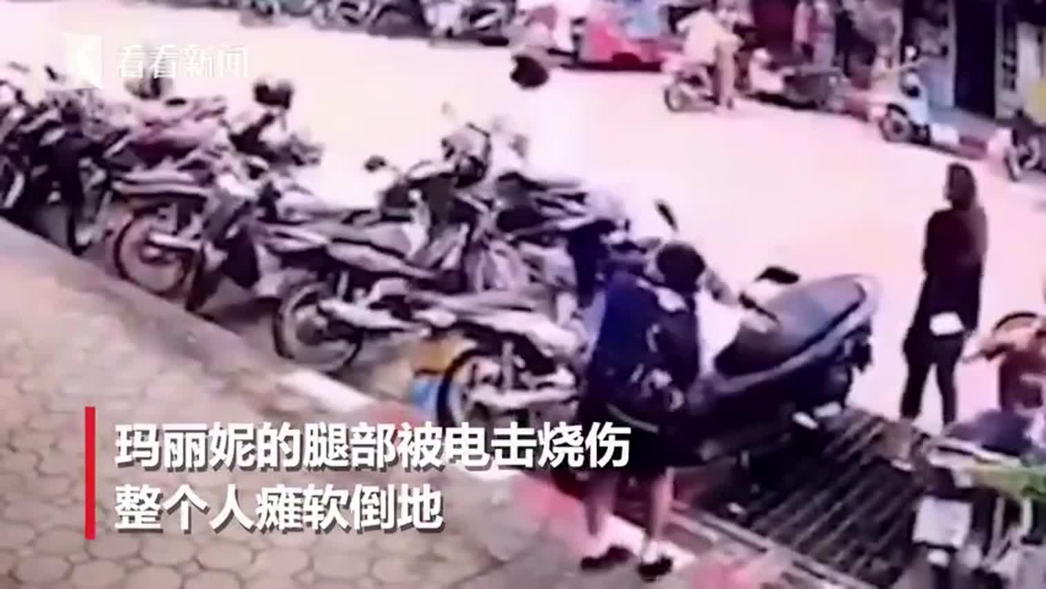 视频-女子过马路被天降2.2万伏电缆砸中 瞬间触